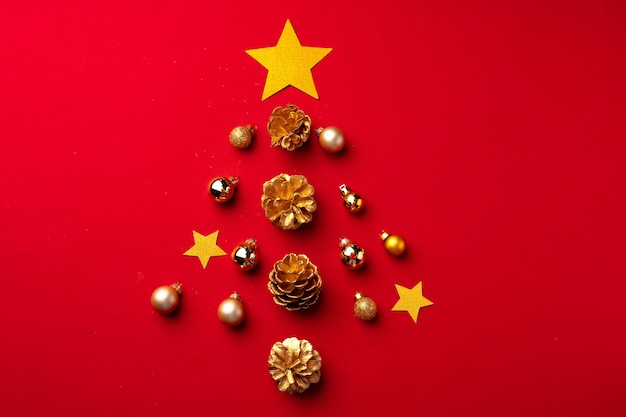Red christmas composition with gold cones and decorations top view