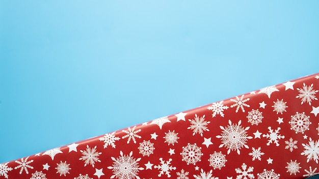 Red christmas gift box top view isolated on blue background copyspace