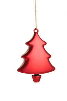 白い背景で隔離の赤いクリスマスプラスチックモミの木。ミニマリズム。