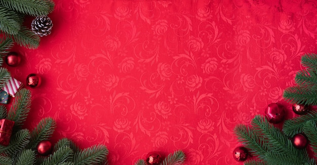 Red christmas texture background with christmas decorations.