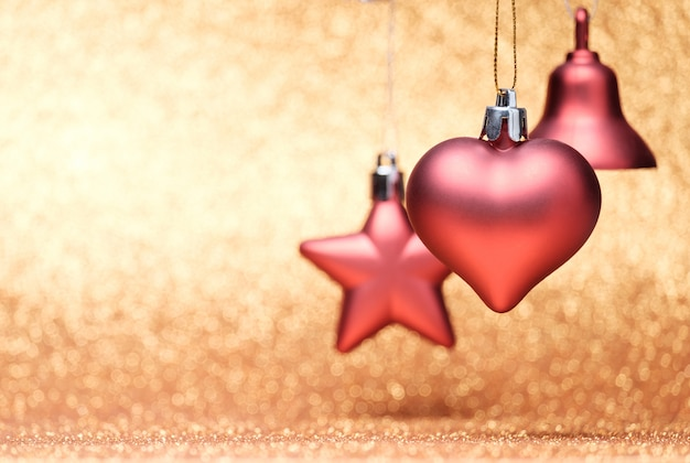 Red christmas toys on glitter background