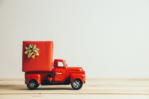 Red christmas truck and gift. merry christmas and happy new year concept.