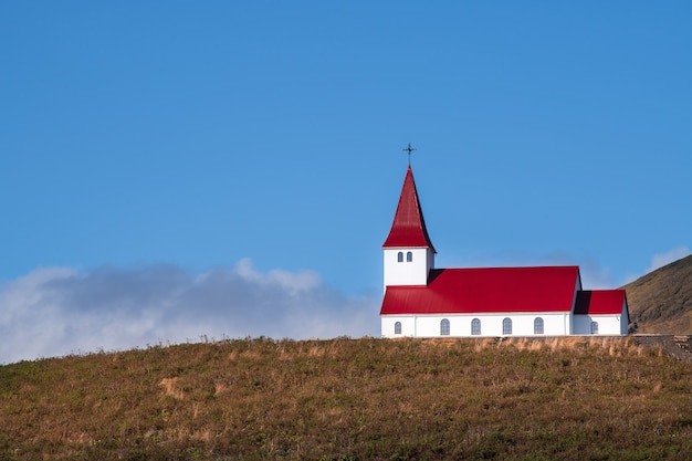 Red church on the montain with blue sky in iceland