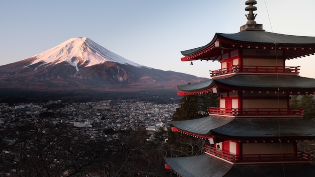 Red chureito pagoda in japan, with mount fuji behind