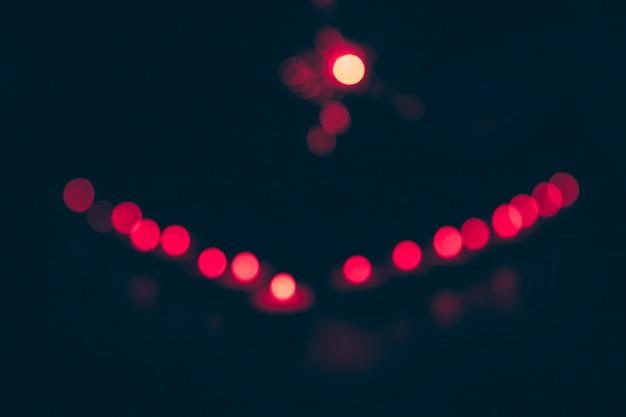 Red circular bokeh on dark background