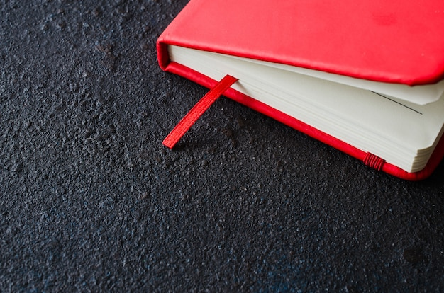 Red closed notebook