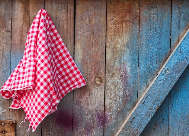 Red cloth in a cell hanging on a wooden cracked wall