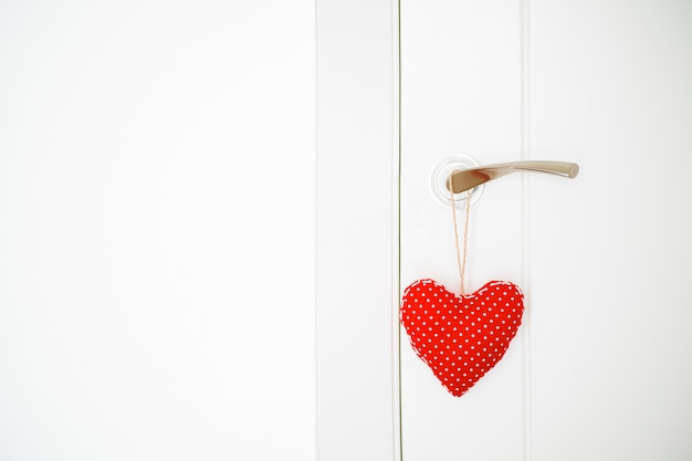 Red cloth heart hung on the door
