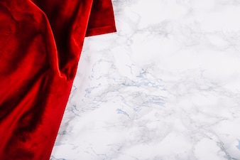 Red cloth on marble background