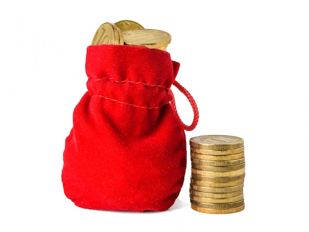 Red cloth pouch with coins and a bunch of coins isolated on white