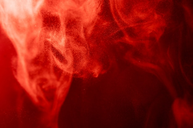 Red cloud of smoke of black isolated background. background from the smoke of vape