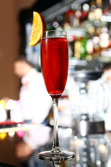 Red cocktail in a champagne glass