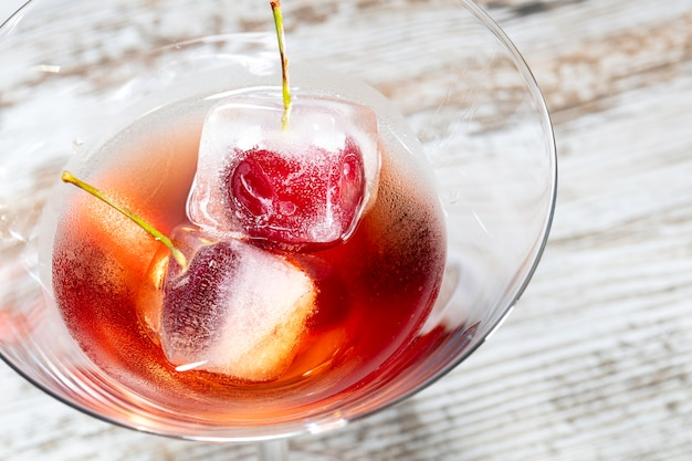 Red cocktail with crerries macro