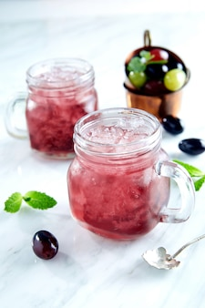 Red cocktail with mint and ice