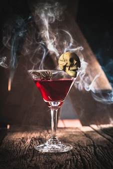 Red cocktail with skull halloween party concept
