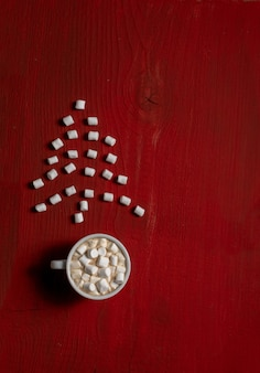 Red coffee cup wooden wood background marshmallow tree top view