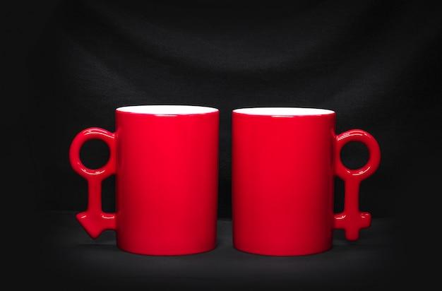 Red coffee mug on dark background.