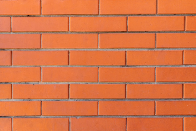 Red color brick wall for brickwork background design