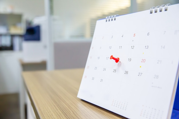 Red color pin on the calendar.