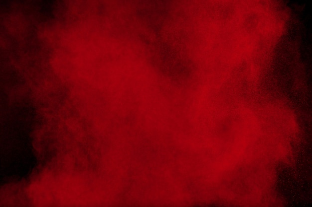 Red color powder explosion on black