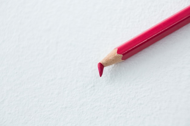 Red colored pencil with broken tip