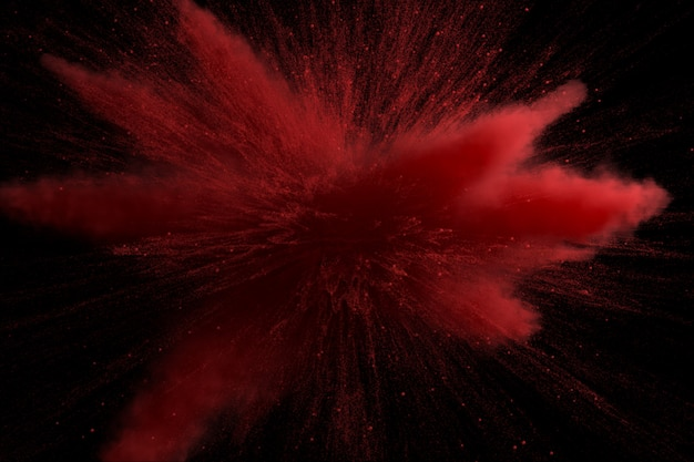 Red colored powder explosion isolated