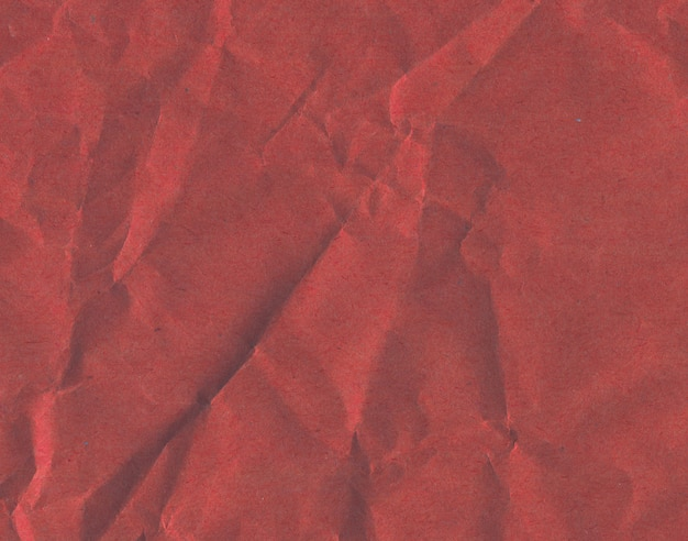 Red colorful paper background. purple cardboard texture