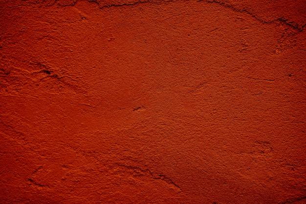 赤いコンクリート、セメントの壁のテクスチャの背景。