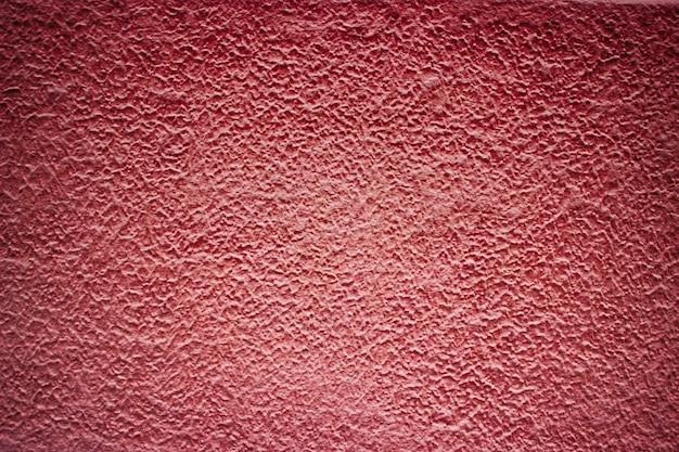 赤いコンクリートの壁の背景セメント色、抽象的な構造の建物