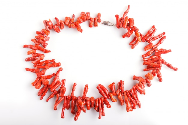 Red coral beads isolated on white background