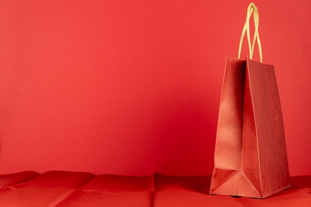 Red craft paper bag on red room