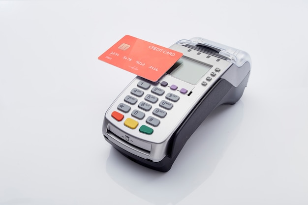 Red credit card and pos terminal