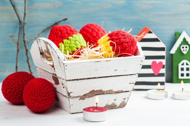 Red crocheted easter eggs in a shabby wooden box