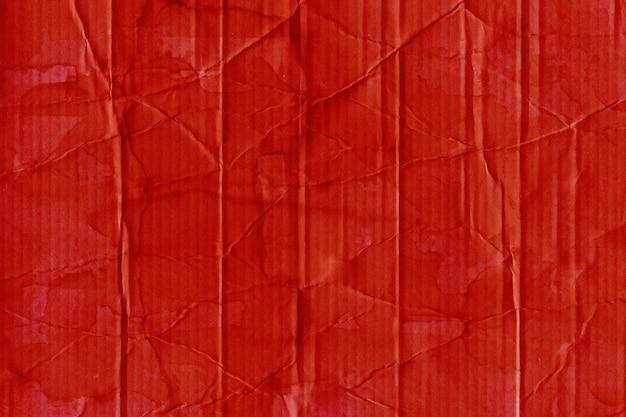 Красный мятый картон текстуры бумаги с эффектом гранж