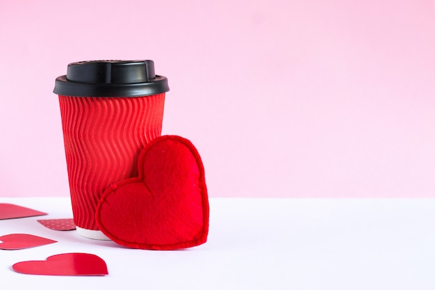 Red cup of coffee and red heart