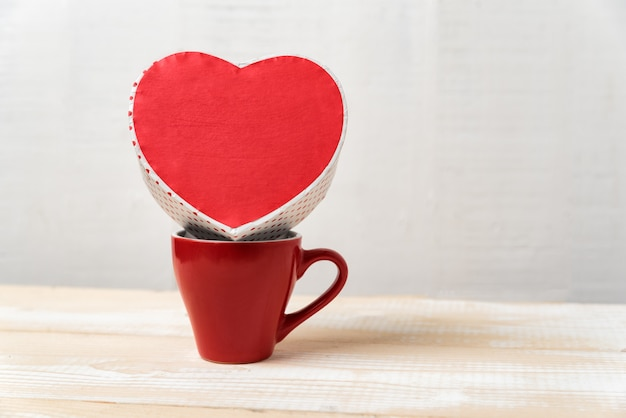 Red cup and heart shaped boxes. gift, valentine's day.