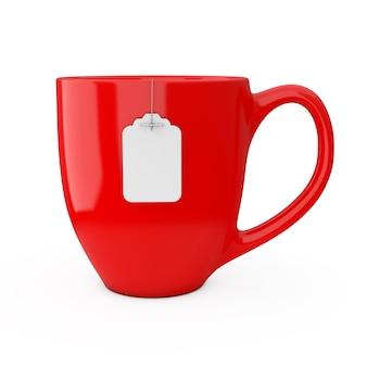白い背景の上の空白の白いティーバッグラベルモックアップとお茶の赤いカップ。 3dレンダリング