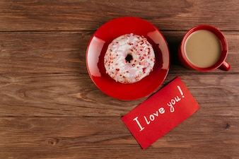 Red cup with doughnut and love note