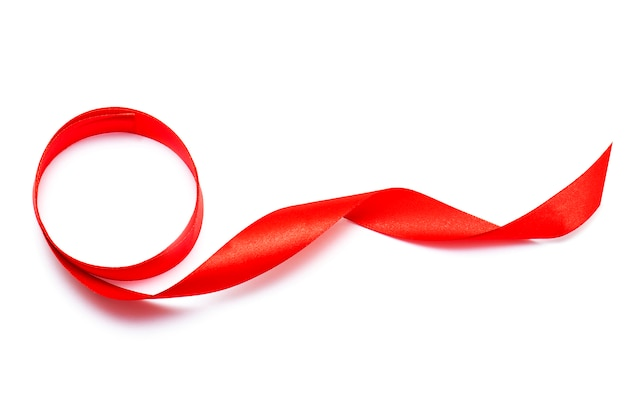 Red curly ribbon tape band top view isolated on white background