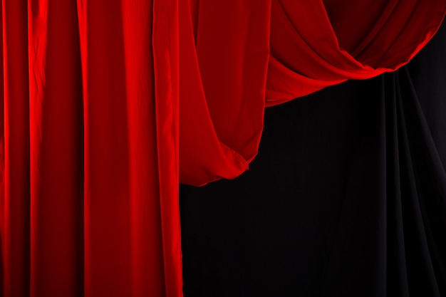 Red curtain drape wave with studio lighting