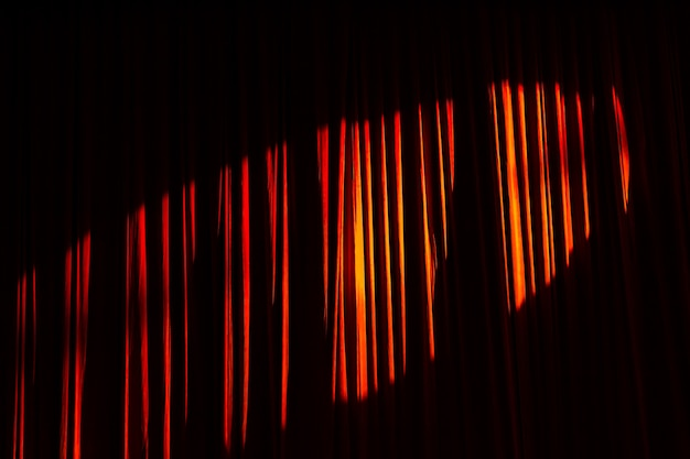 Red curtain and lights in the theater before the show