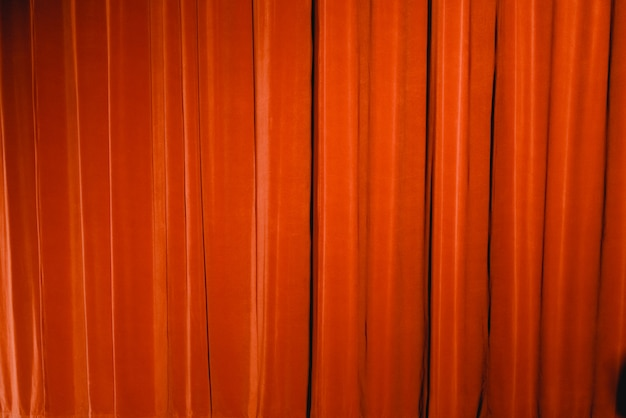 Red curtain of a theater, to use as background of fabrics.