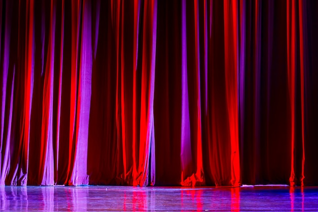Red curtains and the spotlight in the theater between shows.