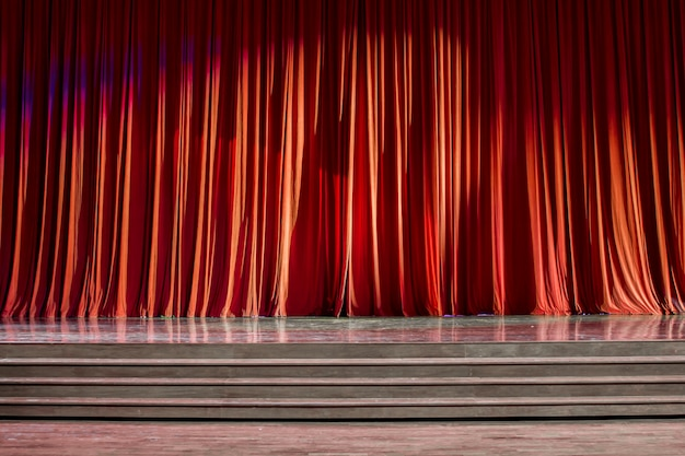 Red curtains and wooden stage.