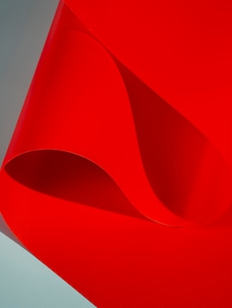 Red curved sheets of paper