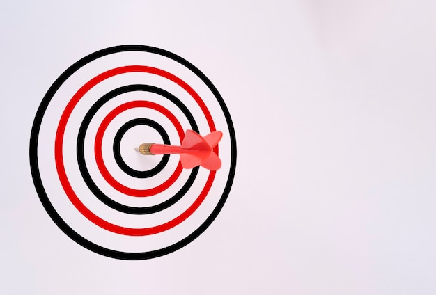 Red dart arrow hit on target board isolated on white