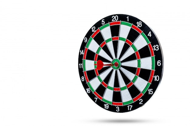 Red dart arrow hitting in the target center is dart board isolated on white surface