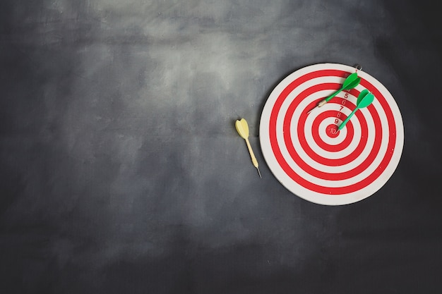 Red dart board and color arrow on background