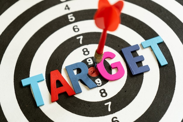Red dart hits in the center of a target isolate on white background