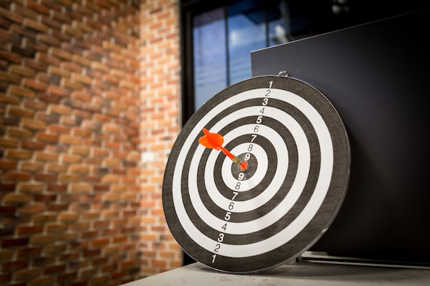 Red dart target arrow hitting on bullseye with, target marketing and business success